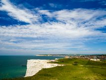 The view from Seaford Heights Seaford Sussex England. People walking on Seaford Heights with the towns of Seaford and Newhaven in the background on a sunny Stock Photos