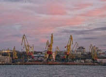 View of seaport with cranes at sunset Stock Photo