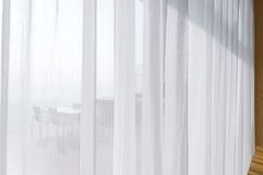 View seascape looking pass Translucent white fabric curtains and Stock Photo