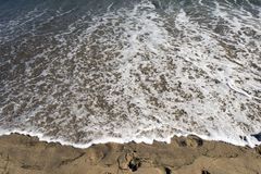 A view of a seascape, Pacific ocean, waves and foams and splash in Malibu, California.  Stock Photo