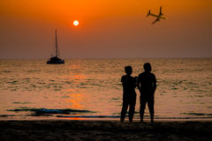 View of seascape silhouette sunset lover with airplane backgroun. D Stock Image