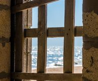 View of the seashore through the boarded up window royalty free stock images