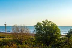 View of the seashore in a clear sunny morning. Country stock images