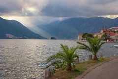 View of seaside Perast town and two islands in autumn evening. Montenegro Royalty Free Stock Image