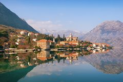 View of seaside Prcanj town on a sunny winter day. Bay of Kotor, Montenegro Stock Images