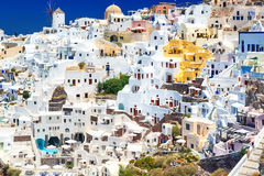 View of seaside on a summer day. Panorama of Oia village with colorful houses , view of Oia town, Santorini island Stock Photos