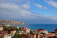View of the seaside town Sudak and  bay.Crimea. Seaside city on the Black Sea.storm clouds over the city Royalty Free Stock Photo