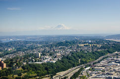 View of the Seattle looking south east. From the 76th floor of the Columbia Center. Mt. Rainier, a massive stratovolcano located 54 miles from the city, can be Royalty Free Stock Photos