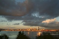 Seattle Skyline During a Dramatic Sunset and a Rain Squall Passing Through. Royalty Free Stock Photos