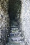 Secret passage excavated in the rock Royalty Free Stock Photography