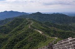 View of a section of the Great Wall of China and the surrounding mountains in Mutianyu. China royalty free stock photo