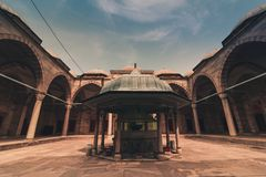 View of the Sehzade Mosque Mosque of the Prince  courtyard with ablution fountain in the middle. Istanbul. Stock Images