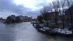 View of the Seine river, Cite island and Pont Neuf from Pont des Arts before the sunrise. Paris, France - January 19,2018: view of the Seine river, Cite island stock video