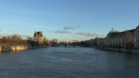 View of the Seine river, Cite island and Pont Neuf from Pont des Arts before the sunrise. Paris, France-January 19,2018: View of the Seine river from Leopold stock video