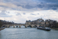 View of the Seine River in Paris against the Conciergerie. Royalty Free Stock Photo