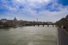 View of the Seine River in Paris in front of the Eiffel tower. Stock Photography