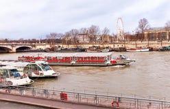 View of Seine river, ships, bridge, coast with ferris wheel in Paris. Royalty Free Stock Photo