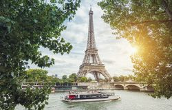 Paris Seine view with Eiffel tower and ship at summer. View from the Seine shore to the eiffel tower in paris. ideal for websites and magazines layouts Royalty Free Stock Photo