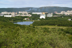 View of the Semenovsky lake and inhabited residential district of the city of Murmansk Stock Photos