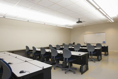 View Of Seminar Room. Empty chairs and tables in front of whiteboards in seminar room Stock Image
