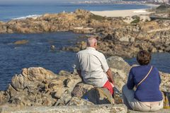 View of senior couple relaxing with view to Leca da Palmeira beach royalty free stock photo