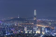 View of Seoul with Lotte World Mall and Seoul tower. SEOUL, SOUTH KOREA - OCTOBER 3: View of Seoul with Lotte World Mall and Seoul tower at night Photo taken on Royalty Free Stock Images