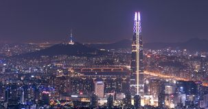 View of Seoul with Lotte World Mall and Seoul tower. SEOUL, SOUTH KOREA - OCTOBER 3: View of Seoul with Lotte World Mall and Seoul tower at night Photo taken on Royalty Free Stock Photo