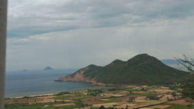 View of Separated Rural Peasant Fields against Sea Hill. Panorama of separated rural peasant fields against azure sea green hill cloudy sky from moving along stock footage