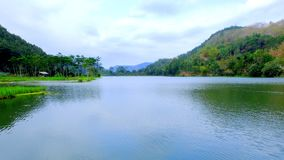 View of serayu river. In Indonesia, show large amount of water area with hill and trees in the background Stock Photography