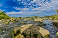 View of a set of stones with the water stream in the river stock photography