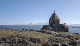 view on Sevanavank Monastery near of Sevan Lake and snowy mountains Stock Photos