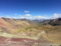 A view of the several hiking paths leading through the incredible Rainbow Mountain and surrounding Andes Mountains outside of Cusc stock photography