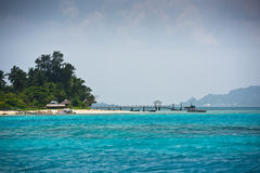 View of Seychelles coastline with a boat pier Stock Images