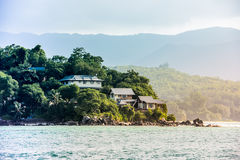 View of Seychelles coastline with houses in the forest Royalty Free Stock Photo
