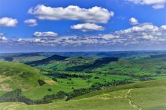 View of shadows cast across the Derbyshire Peaks. Taken on a sunny summer`s day, this image captures the shadows cast by the afternoon sun across Hope valley Stock Photos