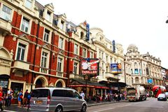 Shaftesbury Avenue theatres London United Kingdom. View of Shaftesbury Avenue with with the Lyric and  Apollo Theatres. Shaftesbury Avenue is a major street in Stock Photos