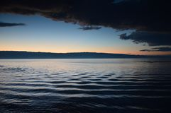 Sunset and swirling water in summer on Lake Baikal, Irkutsk region, Russian Federation. stock photos