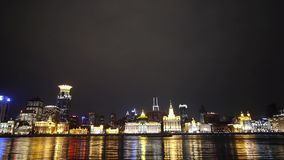 View Shanghai Bund from pudong at night,old style building lights reflect river. stock footage