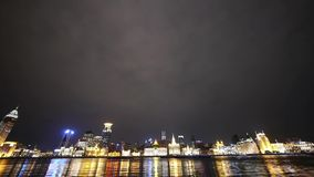 View Shanghai Bund from pudong at night,old style building lights reflect river. View Shanghai Bund from pudong at night,old europe style building neon lights stock footage