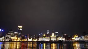View Shanghai Bund from pudong at night,old style building lights reflect river. stock video
