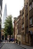 View of the Shard Building. In London taken down a side street in the capital city of England Royalty Free Stock Images