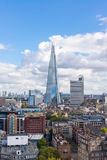 View of the Shard and Guy's Hospital with Canary wharf in the distance. Stock Photos