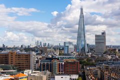 View of the Shard and Guy's Hospital with Canary wharf in the distance. Royalty Free Stock Image