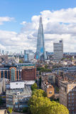 View of the Shard and Guy's Hospital with Canary wharf in the distance. Royalty Free Stock Photography