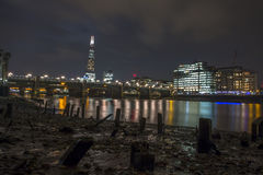 The view of the shard from Low tide Thames stock images