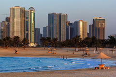 View of Sharjah from the beach of Al Mamzar. Sunset Royalty Free Stock Image