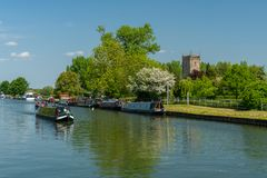 View of the Sharpness - Gloucester canal with St Mary the Virgin Church in the background, Frampton on Severn, Gloucestershire stock image