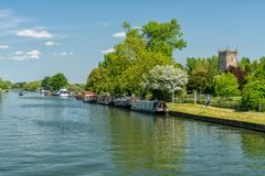 View of the Sharpness - Gloucester canal with St Mary the Virgin Church in the background, Frampton on Severn, Gloucestershire, UK stock photography
