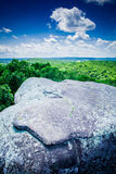 A view of the Shawnee National Forest from Illinois` a Garden of. An exposed rock formation at Illinois` Garden of the Gods in the foreground with the Shawnee stock image