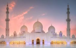 Sheikh Zayed Grand Mosque at sunset Abu-Dhabi, UAE. View of Sheikh Zayed Grand Mosque at purple sunset, Abu-Dhabi, UAE Stock Photo